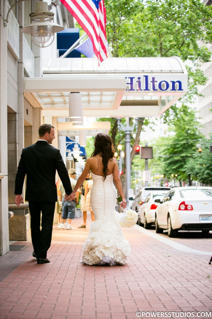Kassab-Couple-Outside-Hilton-Sign-web